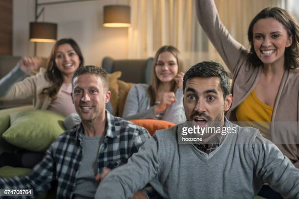 Friends watching game on television