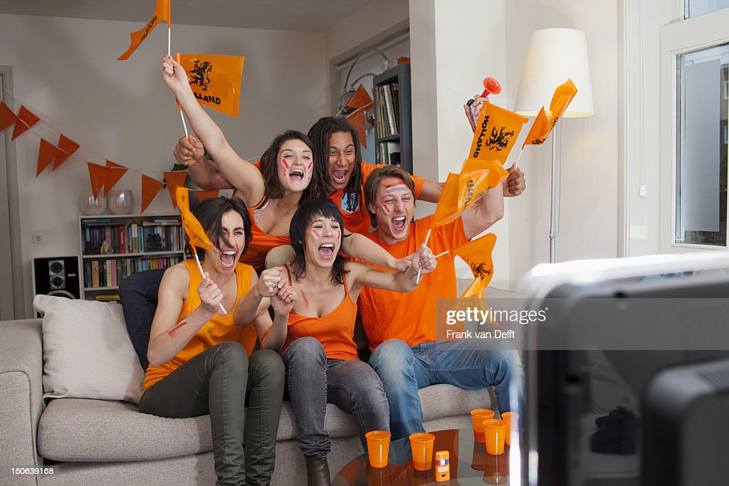 Friends watching sports on television