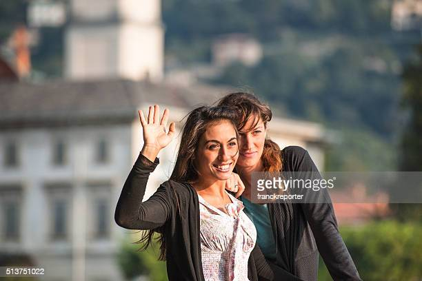 friends waving hands on the summer vacations