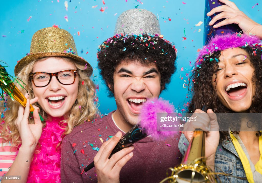 Friends wearing hats at party