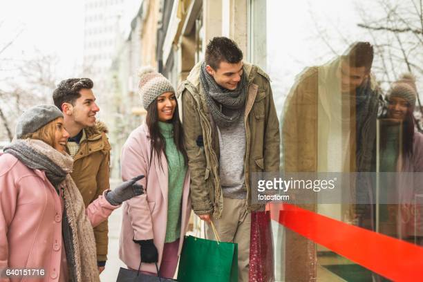 Friends window shopping together