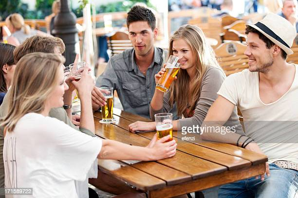 Friends with beer at a sidewalk cafe in Poland