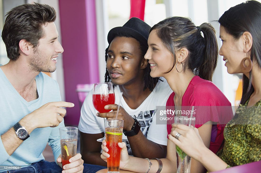 Friends with drinks in a restaurant : Stock Photo