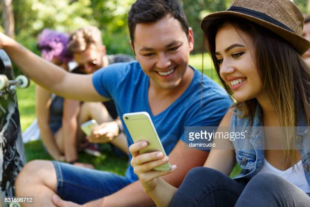 Friends with smartphone outdoor