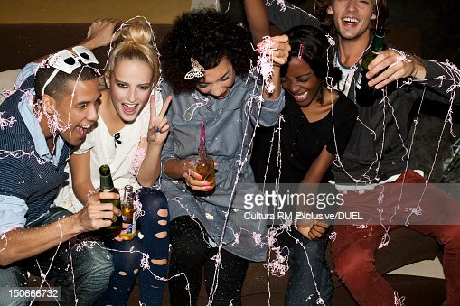 Friends with spray string at party : Stock Photo