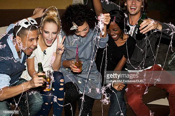 Friends with spray string at party