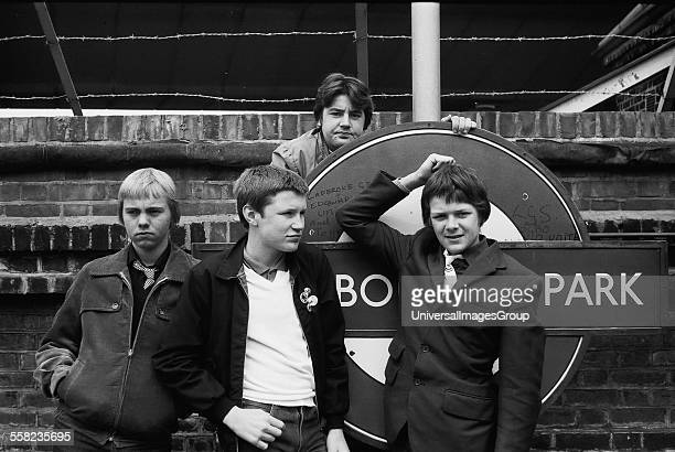 4 Friends with Westbourne park tube station sign in 1980 UK 1980