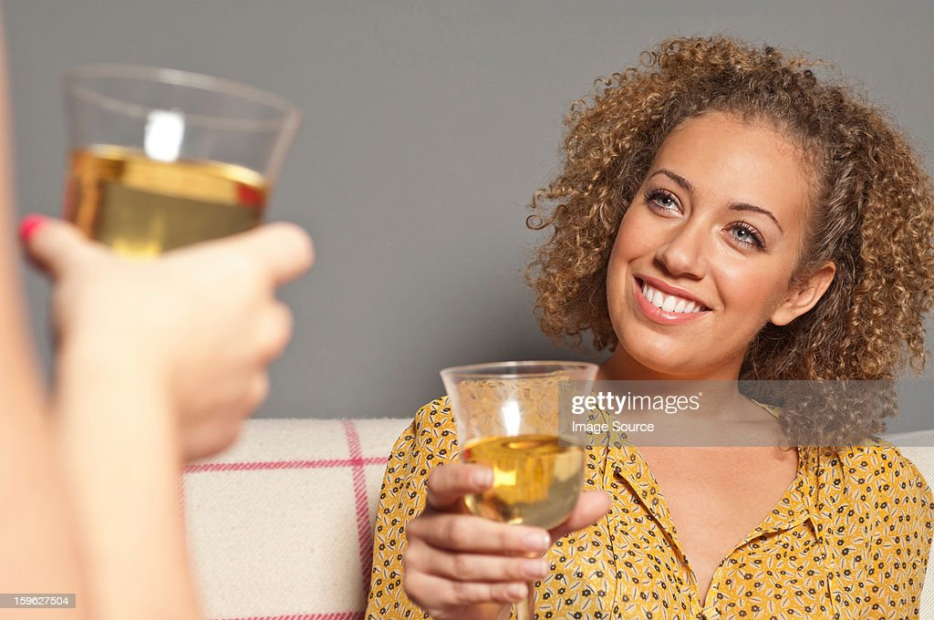 Friends with white wine : Stock Photo