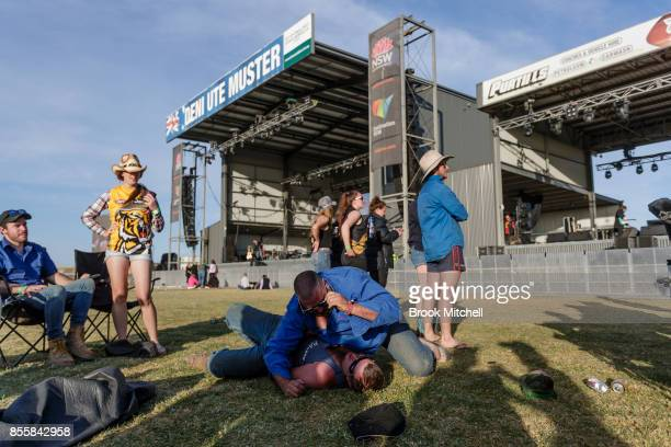 Friends wrestle on the final evening of the 2017 Deni Ute Muster on September 30 2017 in Deniliquin Australia The annual Deniliquin Ute Muster is the...