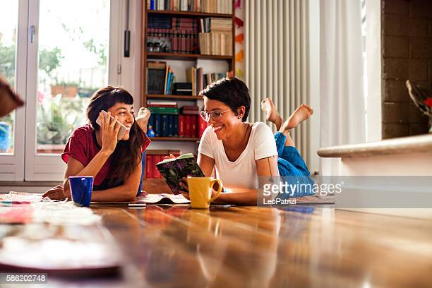 Friends, young woman resting and enjoying coffee at home