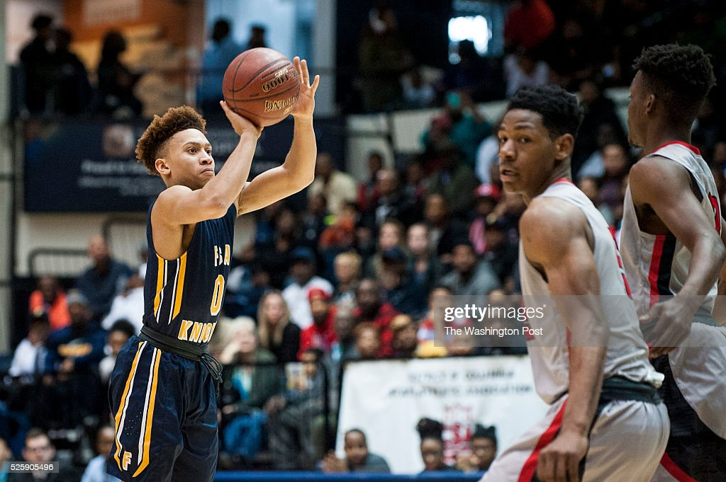 Friendship Collegiate's Alani Moore shoots a three pointer against HD Woodson during first quarter action in the DC State Athletic Association...