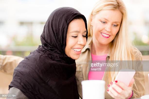 Friendship.  Muslim woman and her friend take selfie.
