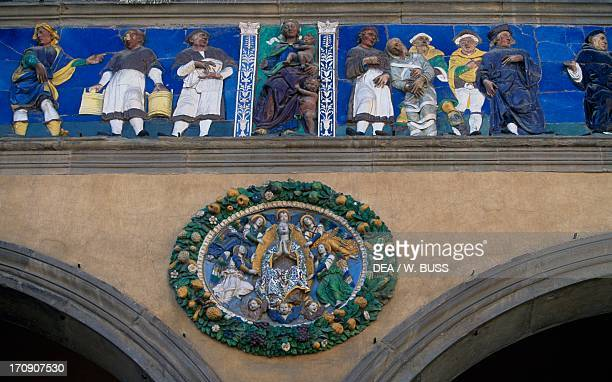 Frieze of the sculptor Santi Buglioni and tondo depicting the Visitation of Giovanni della Robbia Ceppo Hospital Pistoia Tuscany Italy