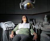Frightened woman in dentist's chair