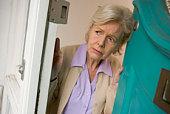 Frightened woman opening door
