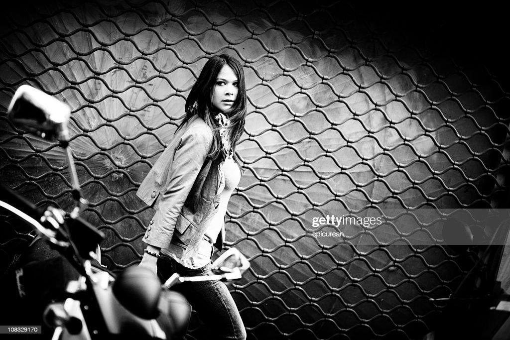 Frightened woman running down a dark street : Stock Photo