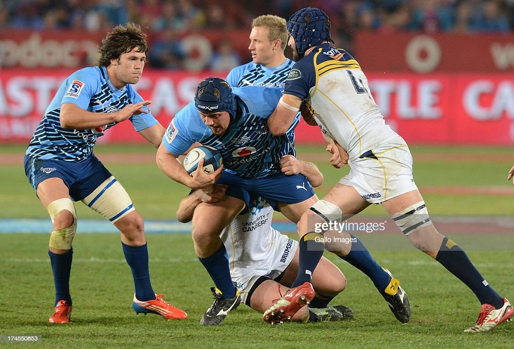 Frik Kirsten of the Bulls is tackled by Scott Fardy (R) of the Brumbies during the SupeRugby semi final match between Vodacom Bulls and Brumbies at Loftus Versfeld Stadium on July 27, 2013 in Pretoria, South Africa.