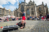 Fringe participants promote their show entertaining people on the Royal Mile during the first day of Edinburgh Festival Fringe on August 7 2015 in...