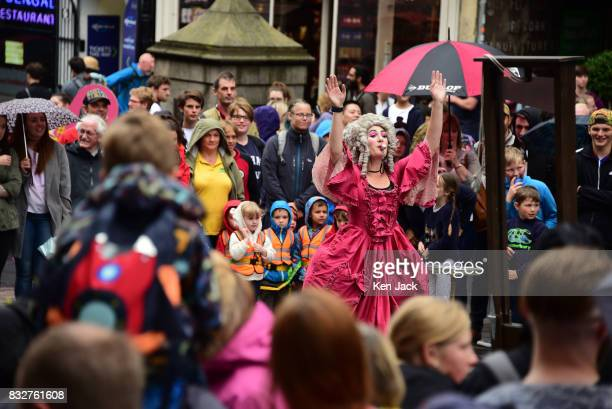 Fringegoers and performers brave the rain during the Edinburgh Festival Fringe on August 16 2017 in Edinburgh Scotland The Fringe is celebrating its...
