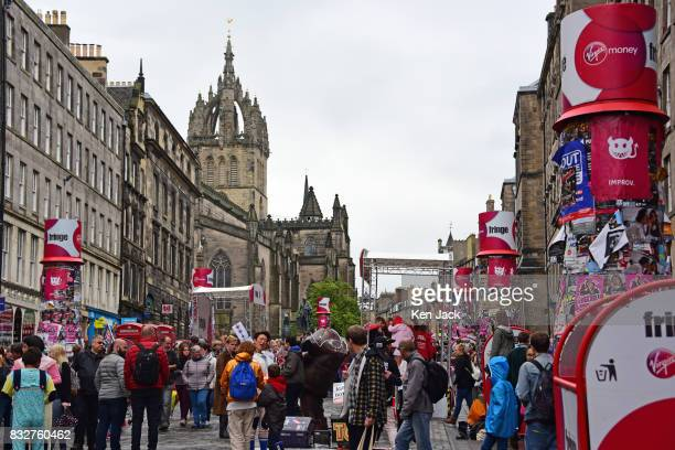 Fringegoers and performers mingle on the Royal Mile during the Edinburgh Festival Fringe with St Giles' Cathedral in the background on August 16 2017...