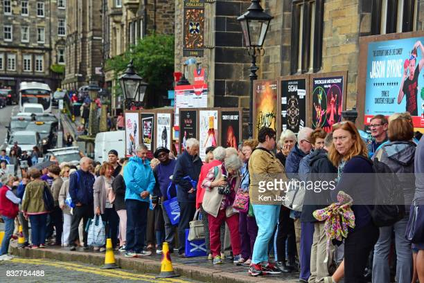 Fringegoers queue for shows on offer during the Edinburgh Festival Fringe on August 16 2017 in Edinburgh Scotland The Fringe is celebrating its 70th...