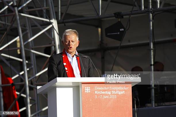 Fritz Kuhn the Lord mayor of Stuttgart talks at the opening ceremony of the 35th German Protestant Church Congress German President Joachim Gauck the...