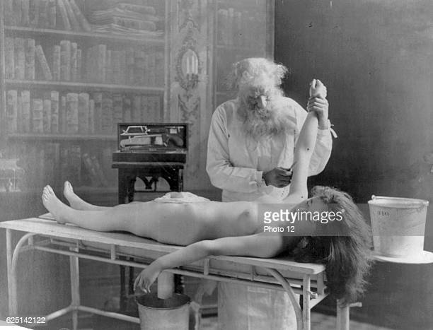 Fritz W Guerin Nude girl on table being autopsied by doctor