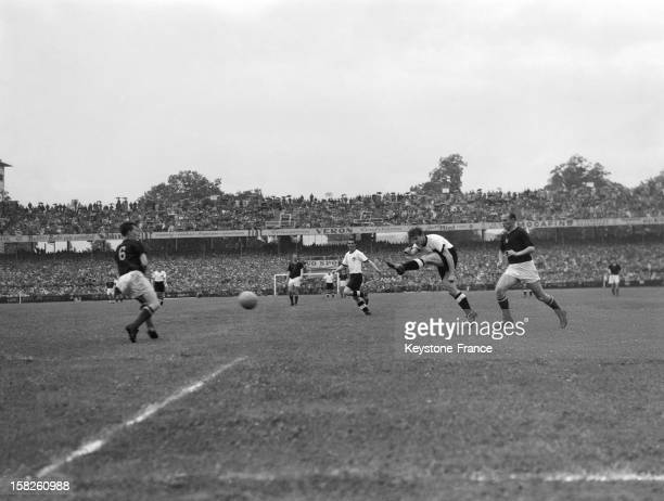 Fritz Walter of West Germany shoots towards goal as Gyula Lorant of Hungary makes a challenge during the FIFA World Cup Final 1954 between West...