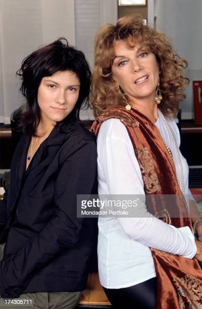 Friulian singersongwriter Elisa Toffoli known as Elisa poses backtoback with her mentor singer and producer Caterina Caselli in the same year Elisa...