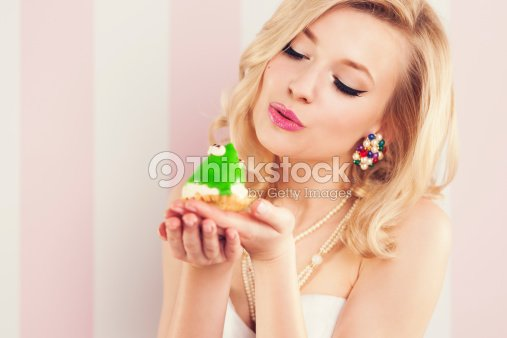 Frog prince being kissed by a beautiful glamour woman : Stock Photo