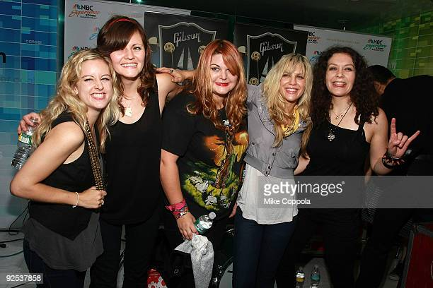 From 2nd left Brett Anderson Maya Ford Allison Robertson and Amy Cesari of The Donnas pose for pictures at the NBC Experience Store as part of the...