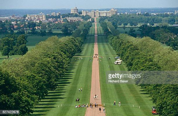 From a high viewpoint on Snow Hill we see the green 'Long Walk' in the Royal Estate's Windsor Great Park We look down the 3mile straight road into...