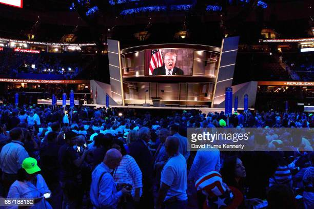 From a large screen above the stage American real estate developer and presidential candidate Donald Trump address the Republican National Convention...