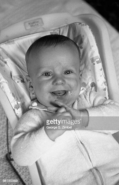 From a series entitiled 'Response to People' images shows a smiling child in a baby chair 1960s