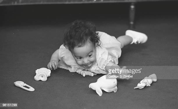 From a series entitled 'Grasping' image shows an infant who reaches for several toys with a 'scooping' motion 1960s