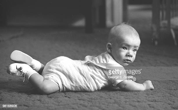 From a series entitled 'Postural Control' an infant raises his head to look around 1960s