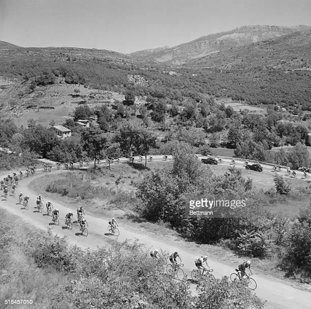 From above all that is evident is the beauty of the scene near Castellane France as cyclists speed along during the annual Tour de France But it's a...