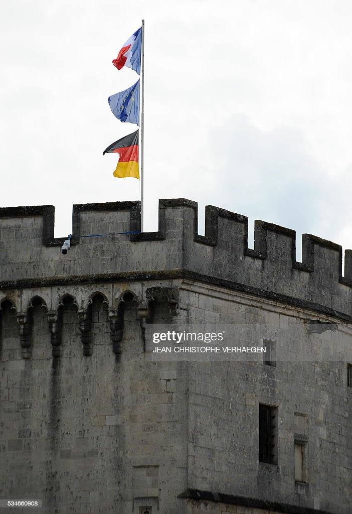 the German, European Union and French flags flutter on May 27, 2016 in Verdun, eastern France. VERHAEGEN
