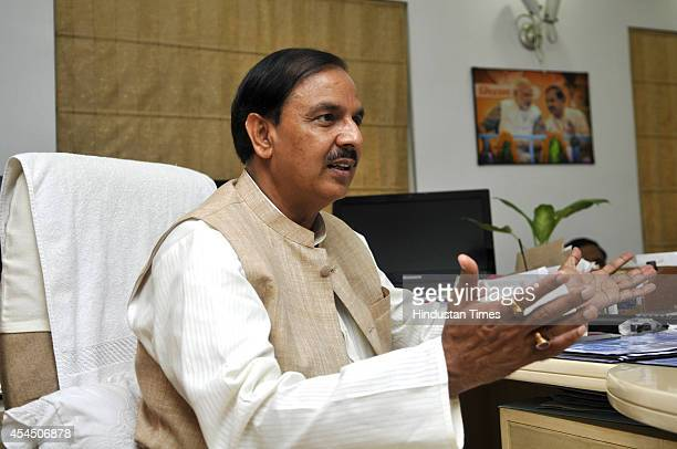 MP from Gautam Budh Nagar Mahesh Sharma brief media about about his ministrys three months performance as MP on September 2 2014 in Noida India The...