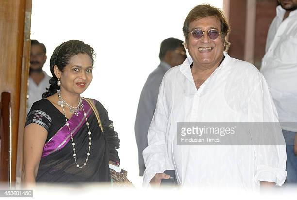 MP from Gurdaspur Vinod Khanna with his wife Kavita Khanna at the Parliament during budget session on August 14 2014 in New Delhi India The Rajya...