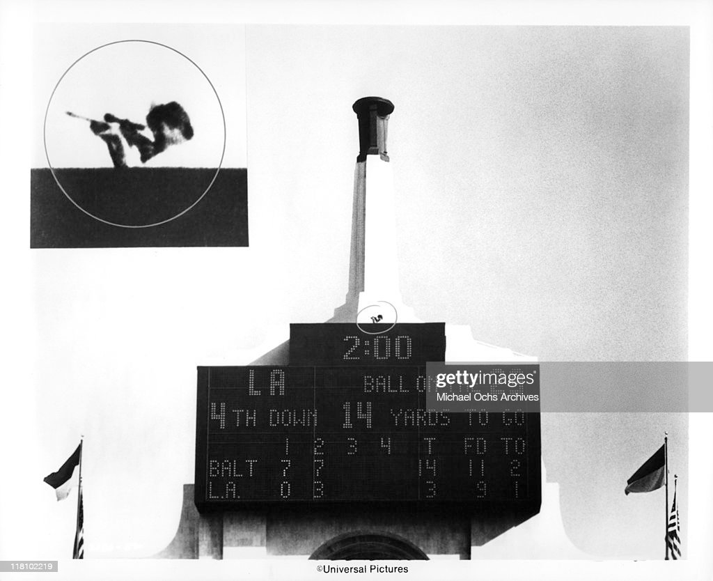 From his perch above the scoreboard at the Los Angeles Coliseum a hidden sniper opens fire in a scene from the film 'TwoMinute Warning' 1976