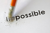 Changing the word impossible to possible with a pencil eraser