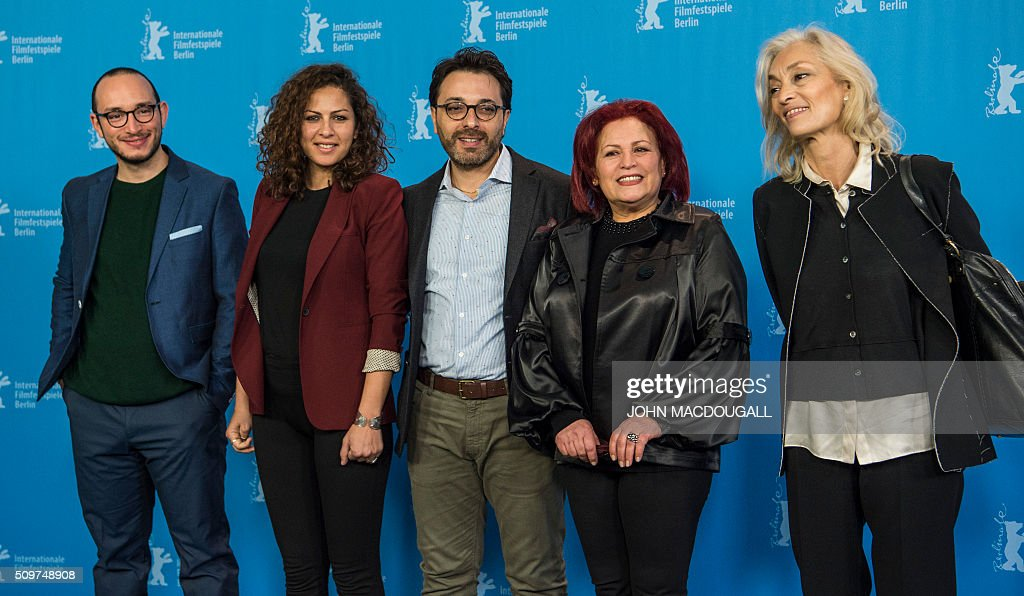 Actor Majd Mastoura, actress Rym Ben Messaoud, director Mohammed Ben Attia, actress Sabah Bouzouita and producer Dora Bouchoucha pose during a photocall for the Tunisian film 'Hedi' during the Berlinale Film Festival in Berlin on February 12, 2016. Eighteen pictures will vie for the Golden Bear top prize at the event which runs from February 11 to 21, 2016. / AFP / John MACDOUGALL