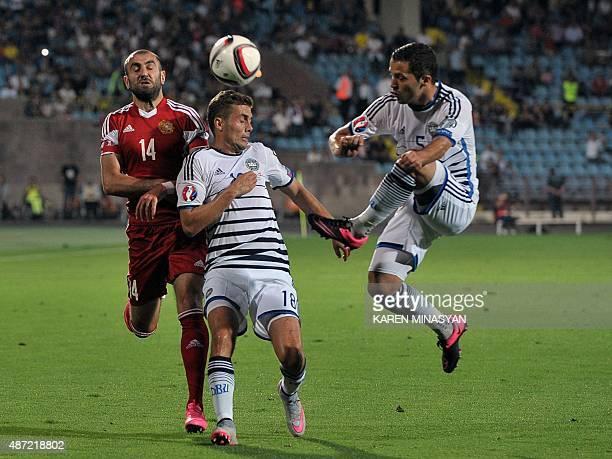 Armenia's forward Yura Movsisyan Denmark's midfielder Jakob Poulsen and Denmark's defender Riza Durmisi vie for the ball during the Euro 2016...