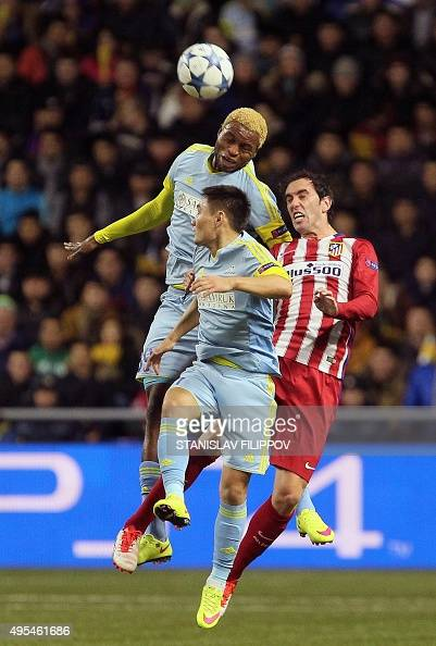 Astana's Congolese forward Junior Kabananga and Astana's Kazakh midfielder Serikzhan Muzhikov vie for the ball with Atletico Madrid's Uruguayan...