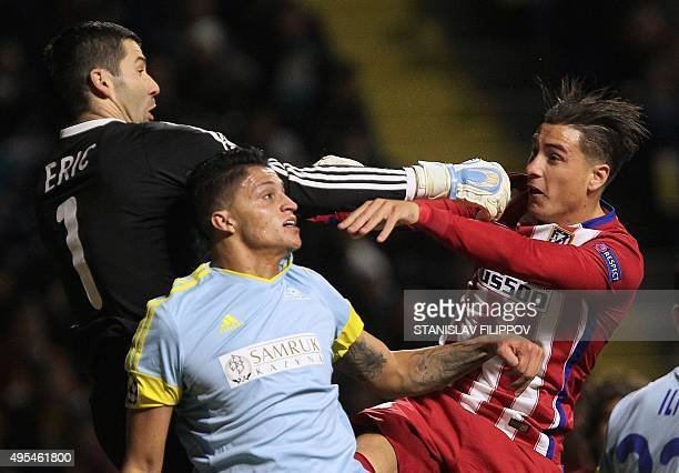 Astana's Serbian goalkeeper Nenad Erich and Astana's Colombian midfielder Roger Henao Canas vie with Atletico Madrid's midfielder Saul Niguez during...