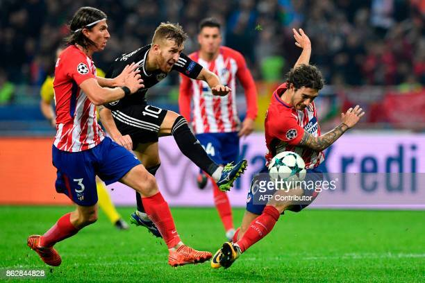 Atletico Madrid's defender from Brazil Filipe Luis Qarabag's midfielder from Brazil Pedro Henrique and Atletico Madrid's defender from Croatia Sime...