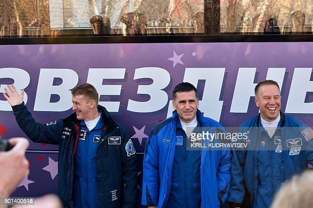 Britain's astronaut Tim Peake Russian cosmonaut Yuri Malenchenko and US astronaut Tim Kopra pose for pictures near a bus during a sendingoff ceremony...