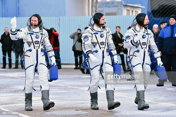 Britain's astronaut Tim Peake Russian cosmonaut Yuri Malenchenko and US astronaut Tim Kopra walk after their space suits were tested at the...