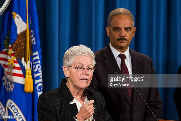 From L EPA Administrator Gina McCarthy speaks as US Attorney General Eric Holder looks on during a press conference to announce a settlement between...